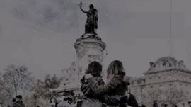 French people hug in the Place de la Republique, Paris, 16 November 2015