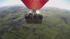 Hot air balloon above countryside