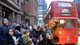 Commuters trying to board London bus