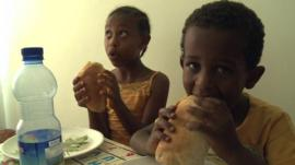 Boy and girl eating bread