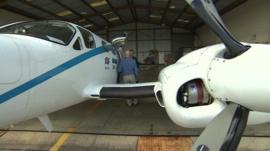 Joss Kent and Peter Gibbs next to Met Office plane