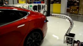Tesla robotic charger