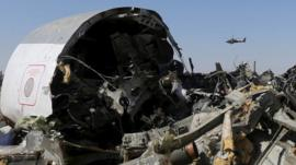 An Egyptian military helicopter flies over debris from a Russian airliner which crashed at the Hassana area in Arish city, north Egypt, in this file photograph dated November 1, 2015