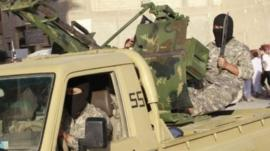 So-called Islamic State militants on an armoured pick-up truck