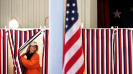 A woman exits a polling booth