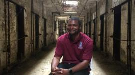 Tour guide Russell Craig in a cell block at Eastern State Penitentiary