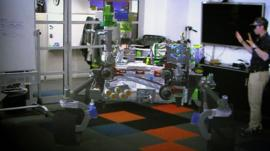 An augmented reality image of a Mars rover design