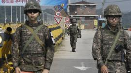 South Korean army soldiers on Unification Bridge near the border village in South Korea where talks are taking place with the North
