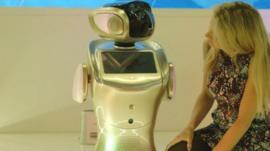BBC Click's Jen Copestake (R) and a robot (L)