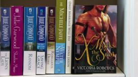 romantic fiction on a shelf
