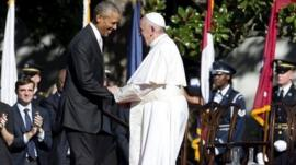 President Barack Obama and Pope Francis shake hands