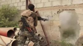 Fighter firing gun in Syria