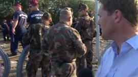 BBC reporter Christian Fraser reporting as Hungarian police work to put up wire at a stretch of the Hungarian border with Serbia