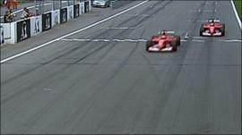Michael Schumacher overtakes Rubens Barrichello