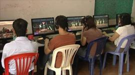People in internet cafe
