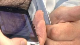 Phone being pressed to a man's chest