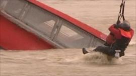 Man rescued as boat sinks