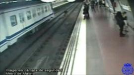 The man is pulled clear of the incoming train