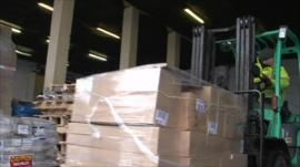 Delivery truck in warehouse