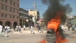 Protesters set tyres on fire