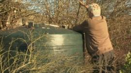 Man checking oil tank