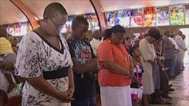 People praying in South Africa