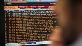 A trader looks at a computer screen