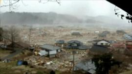 Tsunami washes away homes