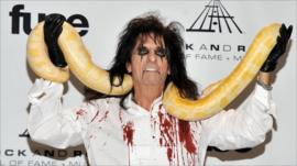 Alice Cooper poses with a snake