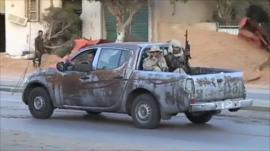 Armed men in a vehicle