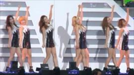A Korean pop band performing on stage