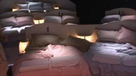 The audience sleep in beds