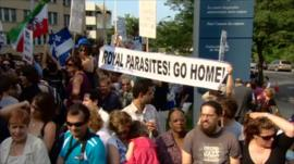 Protesters hold a banner outside the Sainte-Justine Hospital in Montreal