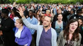 People gathered at a peace rally in Summerfield Park in Birmingham