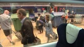 Rory Cellan-Jones walking through Paddington station while viewed through train window