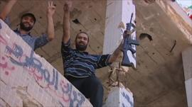 Rebels at Colonel Muammar Gaddafi's former compound