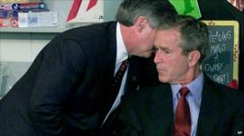 George W Bush is whispered news of the 9/11 attacks