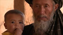 Afghan man with child