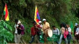 Protesters walk along mountain roads