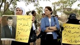 Jordanian women hold banners at sit-in