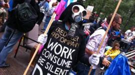 A protestor where a mask at the Occupy Wall Street demonstration