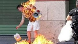 Greek man Apostolos Polyzonis in flames outside a bank in Thessaloniki after setting himself on fire (September 16, 2011)