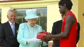 Queen receives Aussie rules football
