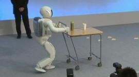 Asimo the robot pushes drinks trolley