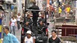 Heavily armed police are now patrolling Rocinha's streets