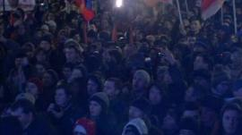 Crowds chant
