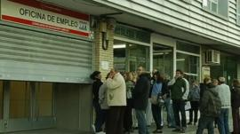 Workers wating outside a job centre in Spain