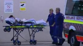 Shark attack victim being taken to hospital