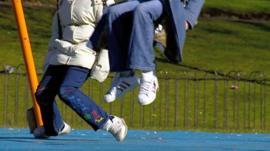 Children on swings in a park