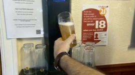 A pint being poured using the beer dispenser